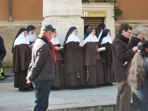 A flock of nuns standing a little way behind me