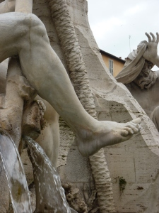 I've posted several photos of the Four Rivers Fountain, including a view in the summer photo above, so here's a close-up of River Gange's foot