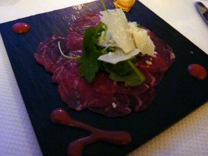 First course: beef carpaccio with parmaggiano