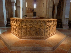 Duomo baptistery - the octagonal baptismal font depicts eight scenes from the Bible