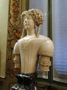 Bust of Olimpia Aldobrandini Pamphilj, by Giovanni Lazoni da Carrara (Aldobrandini Gallery) - doesn't she look like a toy doll?