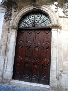 Martina Franca - a mal occhio is mounted over this beautiful door
