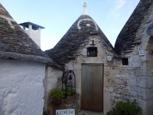 The door, which is typical in Alberobello, is intended to keep bugs out. (photo by K McKenna)