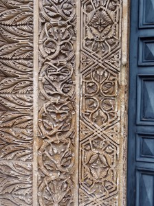 Detail around the door of the Chiesa dei Santi Niccolo e Cataldo